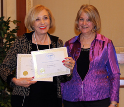 Brenda Warneka receiving 2 awards, presented by Vice President Pam Stevenson.